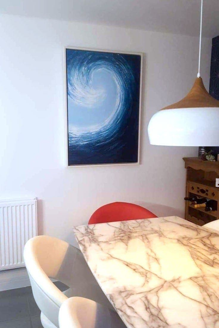 Large Wave painting commissioned from artist Catherine Kennedy. Photo shows the finished painting in the Sue and Dave's dining room.